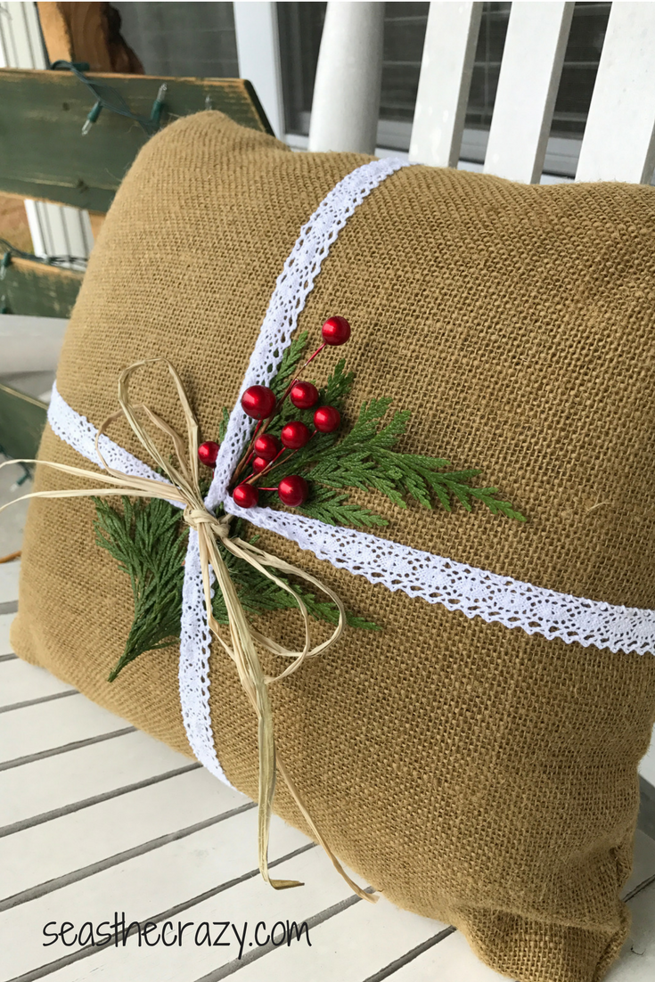 Final product. Burlap pillow upgrade to Christmas burlap pillow for front porch rocking chair. Rainy day Christmas crafts you can do with your kids. seasthecrazy.com